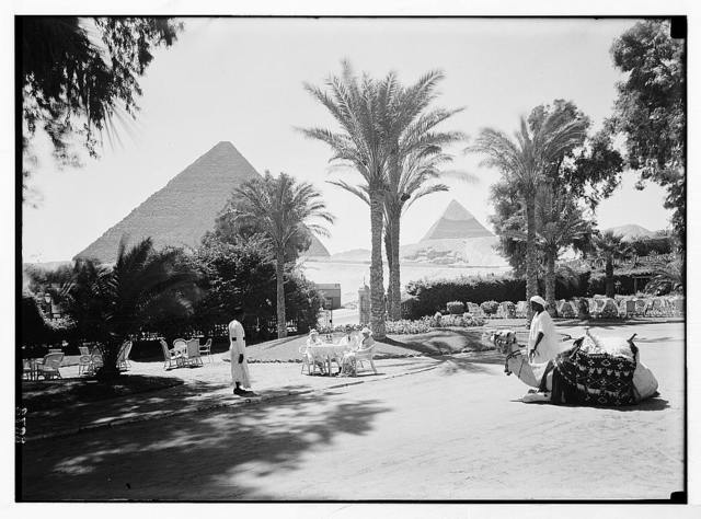 Egypt. Cairo. Hotels. Mena House. Front garden with the two pyramids as background