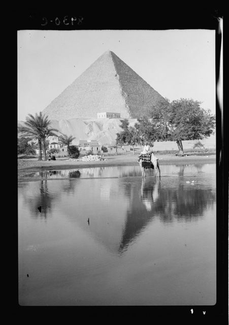 Egypt. Pyramids of Gizeh. The Great Pyramid. Reflecting pyramid & mounted camelmen