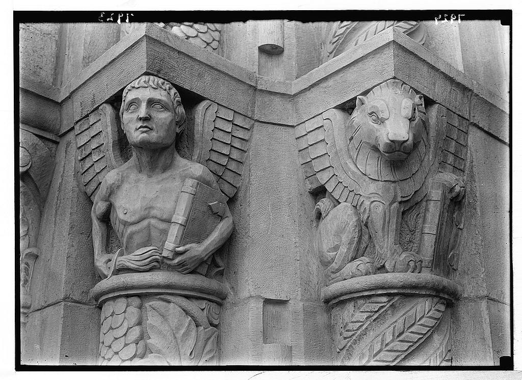 Entrance to Y.M.C.A. Symbolic figure of St. Matthew ; symbolic figure of St. Mark. Lion