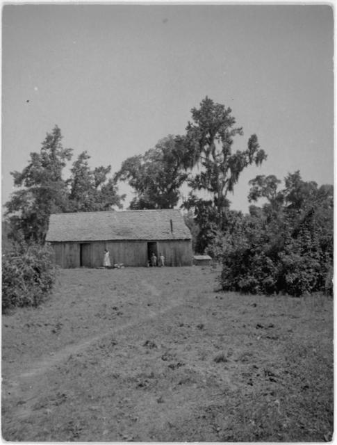 [Exterior view of structure with children standing at the entrance]