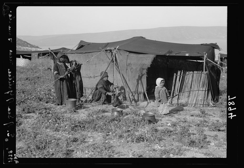 Gamala (Kal'at el-Huson east of the Sea of Galilee). Bedouin tent near the foot of Gamala, Sea of Galilee in background, churning butter
