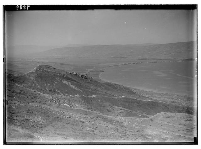 Gamala (Kal'at el-Huson, east of the Sea of Galilee). Telephoto view from summit looking S. showing ruins on southern hill identified as possible Gamala, Samakh & S. end of sea