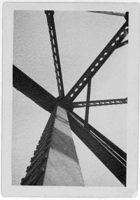 [Girders on an unidentified structure, photographed from below]