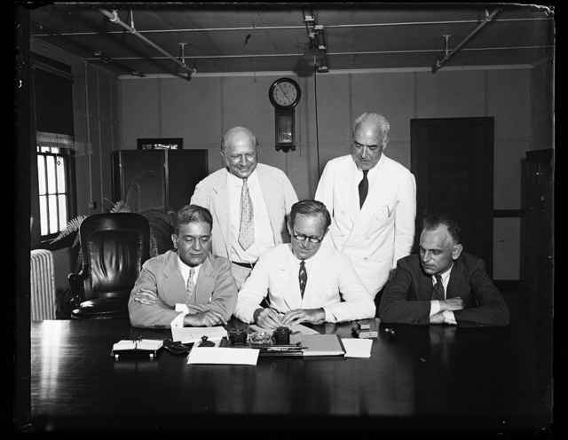[Group: Joseph Kennedy, center]