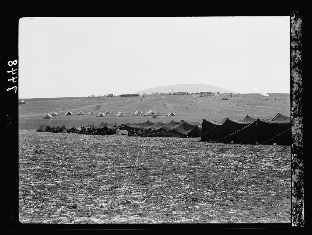 I.P.C. [i.e., Iraq Petroleum Company] camp near Tabor with Bedouin tents. Arab labourers