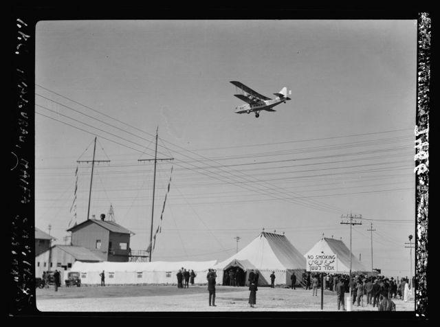 I.P.C. [i.e., Iraq Petroleum Company] terminus in Haifa, with plane overhead