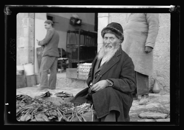[Jewish market in Mea Shearim. Bukaran Quarter, Bukharan man selling vegetables]