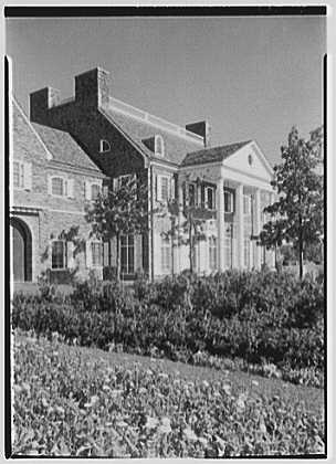 John N. Conyngham, Hayfield Farm, residence in Lehman Township, Pennsylvania. House and portico over marigolds, vertical, a.m.