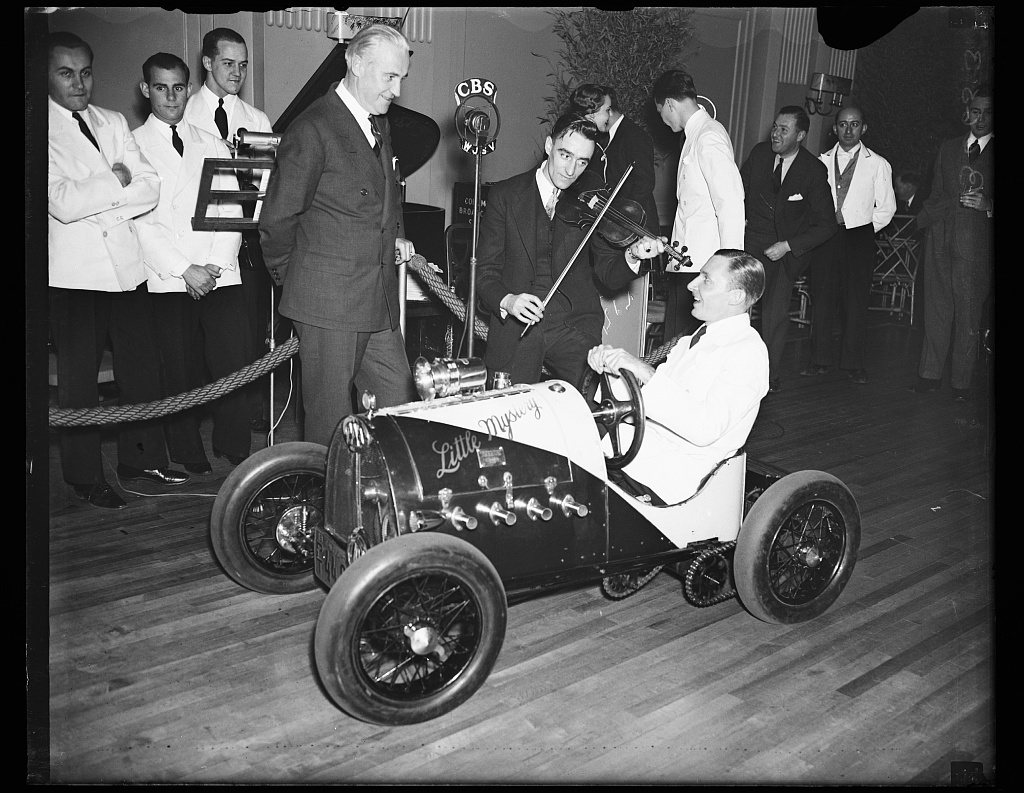 """[Kenneth L. Morehouse and his midget car """"Little Mystery,"""" probably taken at an event at a hotel, Washington, D.C.]"""