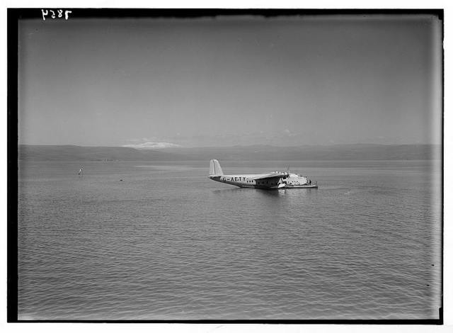 """Lido, flying boat Clio. Flying boat """"Clio"""" on the lake with snow-capped Hermon"""