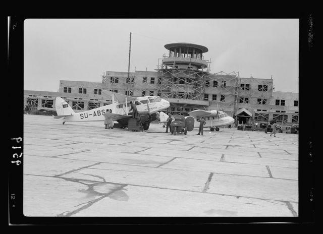 Lydda Air Port. Air Port building showing a Misr plane & Palestine Airways plane