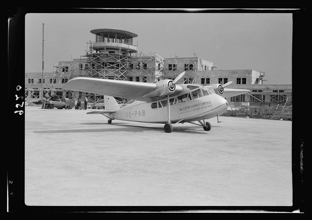 Lydda Air Port. Palestine Airways plane in front of building