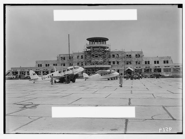 Lydda Airport. Airport building showing a Misr plane & Palestine Airways plane