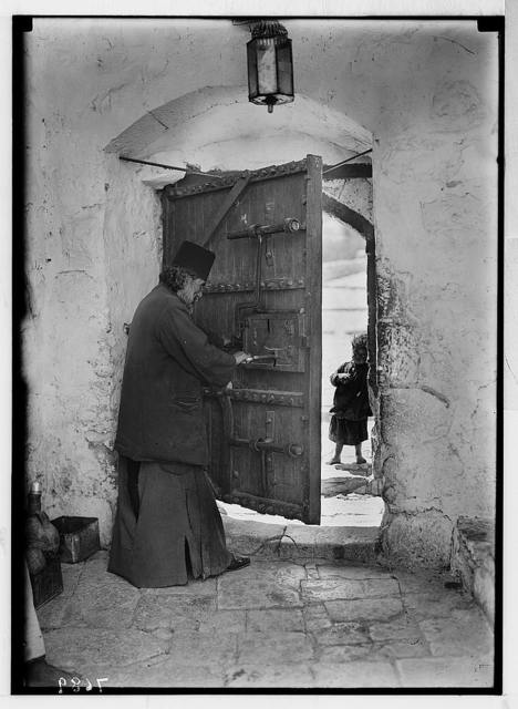 Mar Saba. Doorway with monk (looking out)