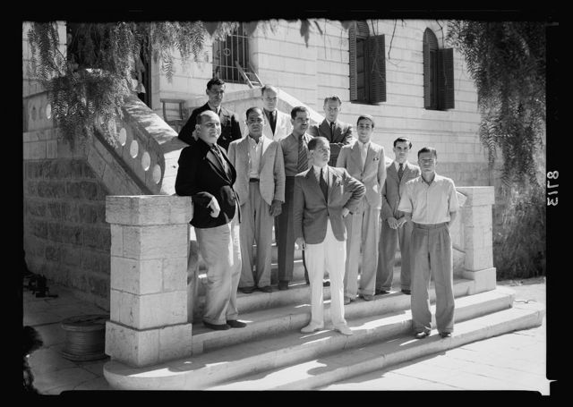 New broadcasting studios on Queen Milisande's Way, Jerusalem. Group of engineering staff, on front steps of P.B.S. [i.e., Palestine Broadcasting Service] bld'g. in sun light
