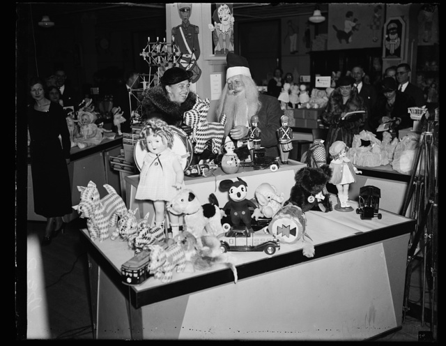 NO ELEPHANT TOYS FOR FIRST LADY. MRS. ROOSEVELT, ON A CHRISTMAS SHOPPING TOUR, HAD A HARD TIME CONVINCING SANTA CLAUS THAT SHE DID NOT WANT A TOY ELEPHANT, A SYMBOL OF THE REPUBLICAN PARTY, AS A CHRISTMAS PRESENT. SHE IS SHOWN HERE INSPECTING AN ASSORTMENT OF TOYS AT A WASHINGTON, D.C. DEPARTMENT STORE FRIDAY