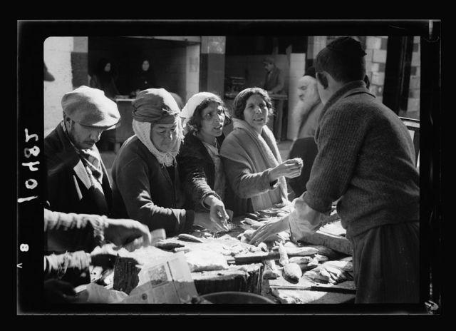 Orthodox Jew buying fish