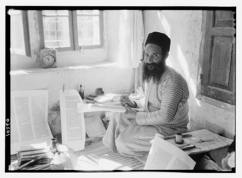 Orthodox Jewish scribe [Shlomo Washadi] writing the Torah on parchment