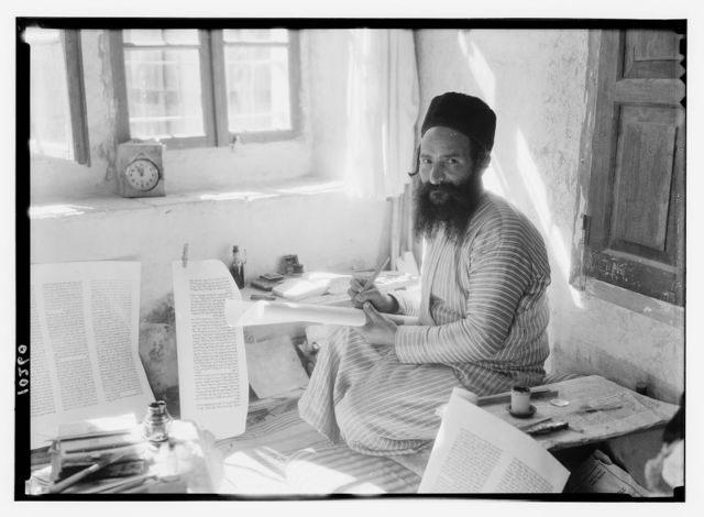 Orthodox Jewish scribe [Shlomo Washadi] writing the Torah on parchment