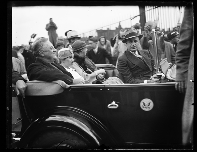 PRESIDENT AND FAMILY LEAVING UNION STATION. PRESIDENT ROOSEVELT LEAVING THE UNION STATION WITH HIS FAMILY AFTER HE WAS GREETED BY A COUPLE OF HUNDRED CONGRESSMEN, WHO CRANED THEIR NECKS AND GAPED JUST LIKE ANY OTHER GUY IN THE STREET. WITH THE PRESIDENT AARE: MRS. CURTIS DALL; MRS. ROOSEVELT; AND JAMES ROOSEVELT