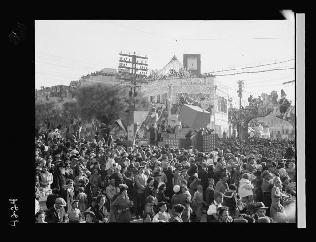 Purim Carnival in Tel Aviv. 1934. Purim celebration in Tel Aviv. The Hitler float. Three large dragons driven by the Nazi leader