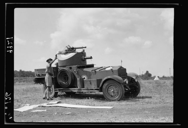 "R.A.F. activities. A ""T"" signal and a flare light signal being fired by officer of armoured car [Ramleh Aerodrome]"