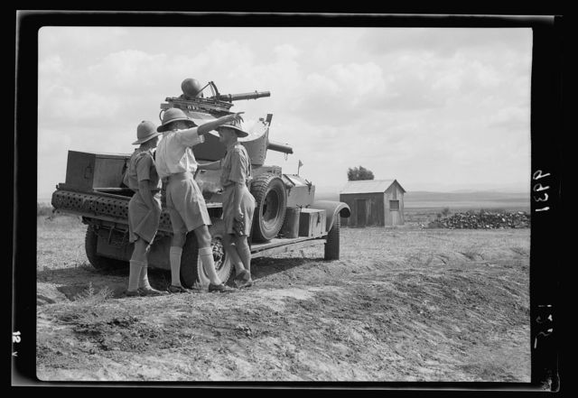 R.A.F. activities. Armoured car officer giving instructions to the crew [Ramleh Aerodrome]