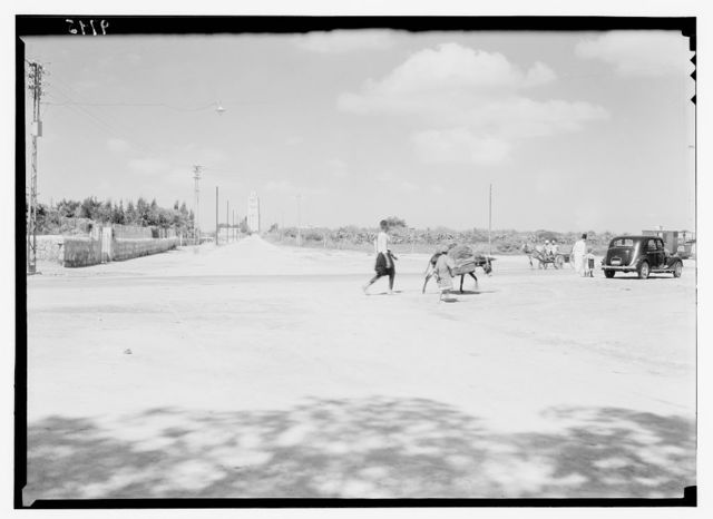 Ramleh, Tel-Aviv. Jaffa road passing through Ramleh showing Tower of Forty Martyrs in dist[ance]