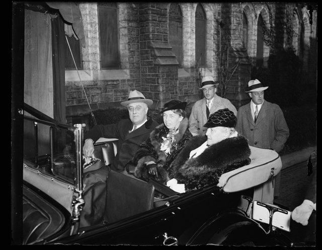 ROOSEVELTS ATTEND CHRISTMAS SERVICES. THE ROOSEVELT FAMILY ATTEND CHRISTMAS DAY CHURCH SERVICES AT ST. THOMAS EPISCOPAL CHURCH IN WASHINGTON D.C. THIS PHOTOGRAPH SHOWS THE FIRST FAMILY LEAVING THE CHURCH. FROM THE LEFT: PRESIDENT ROOSEVELT, MRS. ROOSEVELT, AND MRS. JAMES ROOSEVELT, THE PRESIDENT'S MOTHER. NOTE THE GORGEOUS ORCHIDS WORN BY THE PRESIDENT'S WIFE