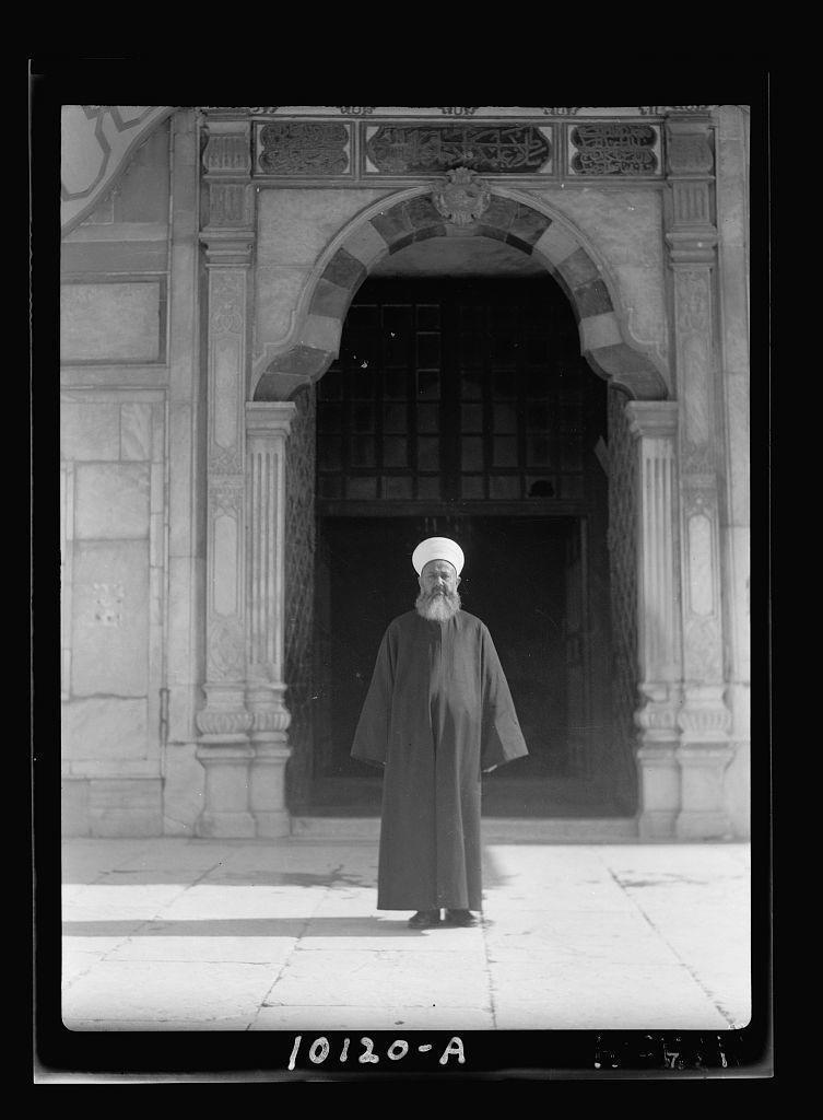 Sheikh Faik el-Insari, procurator of el-Harem Sherif before door of Mosque of Omar [i.e., Dome of the Rock]