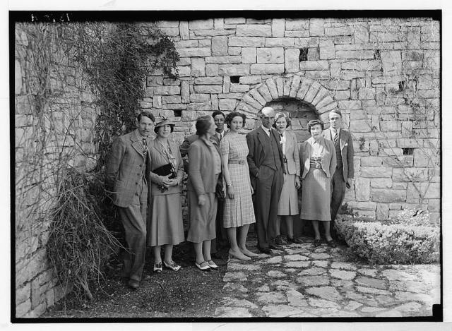 [Sir Harold MacMichael, High Commissioner for Palestine, with house party in sunken garden of residency]