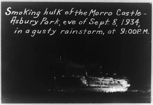 Smoking hulk of the MORRO CASTLE - Asbury Park, eve of Sept. 8, 1934, in a gusty rainstorm, at 9:00 p.m.