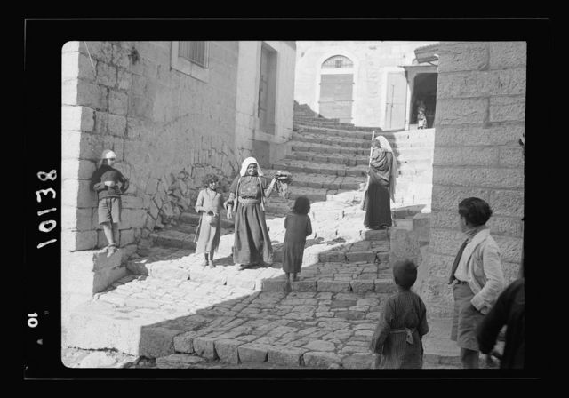 Street of steps in Bethlehem with women and children