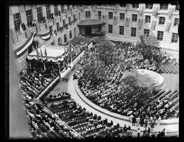 View of dedication of New Post Office Department. A general view showing the crowds that gathered in the court yard of the new Post Office Department building at the dedication ceremonies. Diplomats and those high in governmental life were present. Postmaster General James Farley was the principal speaker. Speaker for the House Rainey also spoke as did Rep. James M. Mead of N.Y. and Rep. Kenneth McKellar of Tennessee, 6/11/34