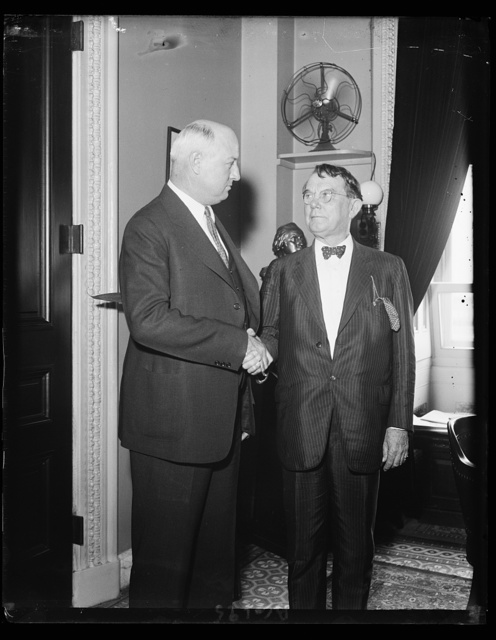 When Congress closed. Postmaster General James A. Farley congratulating Sen. Kenneth McKellar of Tenn., on the passing of the resolution to simplify the airmail routes and contracts, during the last hours of Congress. This photo was made shortly after the 73rd Congress ajourned