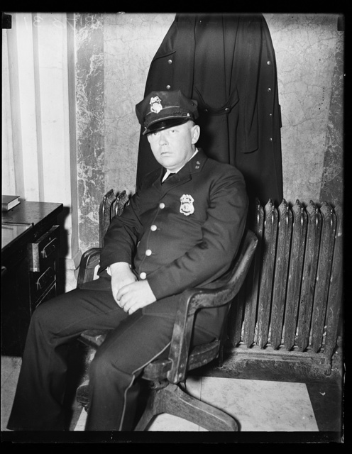 A Slap at Huey? Fred. C. Parker, alleged life threatener of Sen. Huey Long, as he appeared at his post of duty in the House office building where, as a patronage progidy of Rep. Jared Y. Sanders, Jr., of La., he works as a member of the Capitol police force. Parker, a resident of Baton Rouge, La., denies that he threatened the Senator's life. He has been on the payroll since Feb. 5. 2/8/35