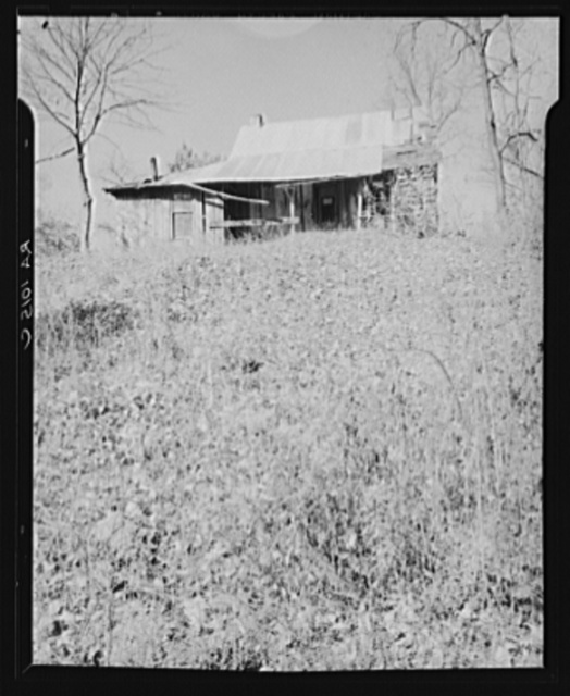 Abandoned house of a resettled farmer who is now moved into a neighboring county. Brown County, Indiana