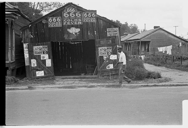 Advertisements for popular malaria cure, Natchez, Mississippi