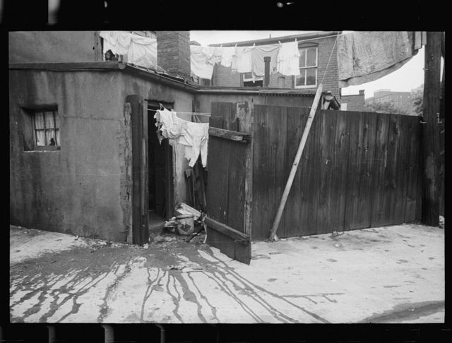 Alley dwelling near Union Station, showing crowded, tiny backyards, Washington, D.C.