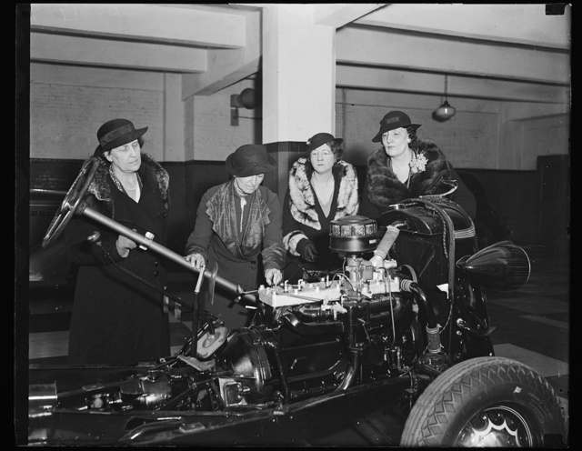 And where does the depreciation hook on? Wash. D.C. Women drivers of the District of Columbia, intent upon finding out why their cars turn right when they signal for a left turn, and vice versa, are attending a driving school sponsored by the D.C. Federation of Women's Clubs. A few of the class is shown here examining a chassis in an effort to find out why certain things happen when certain gadgets are pushed or pulled. From the left: Mrs. Harry W. Wiley, past Pres. D.C. Federation of Women's Clubs; Mrs. Frances Golsen, Organizer and Conductor of the School for Safe Driving; Mrs. Ruth H.Snodgrass, Recording Secretary of the Federation of Clubs, and Mrs. Ernest William Howard, Jr., Chairman of Police and Fire Committee of the D.C. Federation of Women's Clbs. 11/26/35