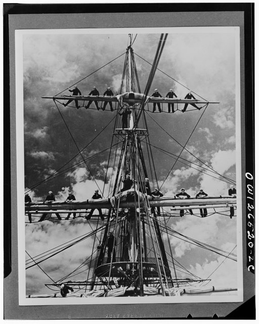 "Apprentice seamen in the United States Maritime Service manning the yards on the square-rigged training ship ""Joseph Conrad"""