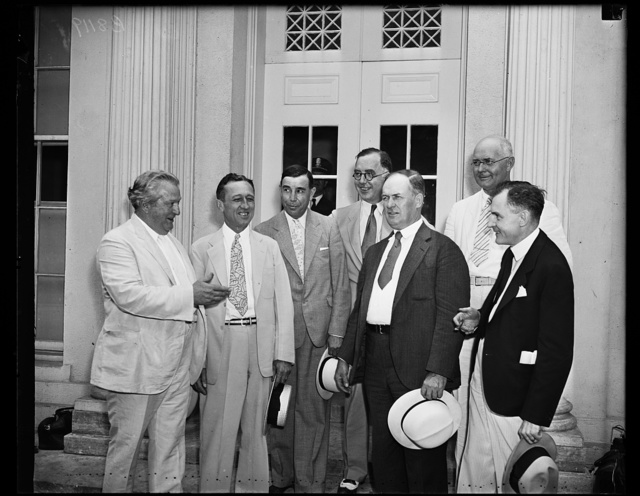 Ask for 113 million... A group of western senators leaving White House after urging Pres. Roosevelt to aid speedy allocation of funds for reclamation and irrigation projects in their states. Left to right: Pat McCarran, D. Nev., Carl Hatch, D. New M., Dennis Chavez (D. New Mex), Lewis B. Schwellenbach (D.Wash), Edward R. Burk (D.Neb), James P. Pope (D.Ida), Homer... Bone (D. Wash), 7/2/35