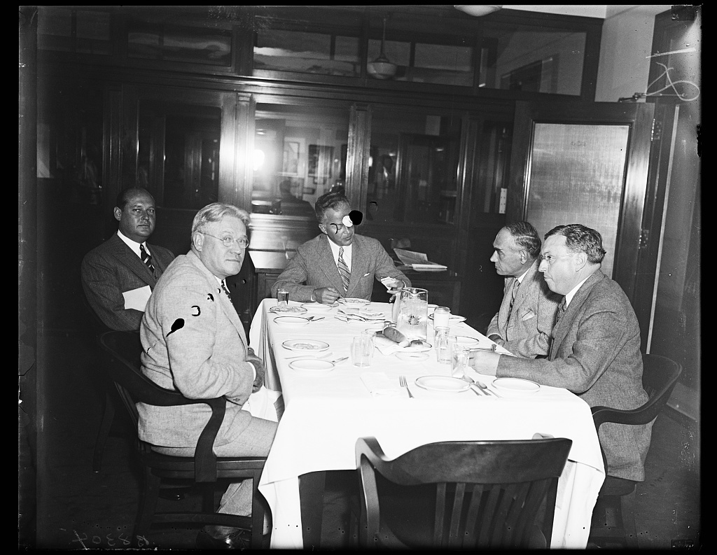 At C of C meeting. David R. Edwards, Boston, vice president of the U.S. Chamber of Commerce, left, and Lee J. Dougherty, Davenport, Iowa, photographed at the buffet luncheon which served as an intermission at the Chamber Council of War on New Deal legislation. 9/20/35