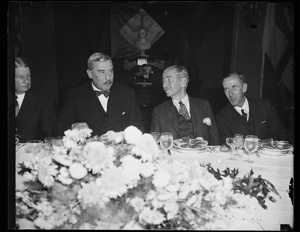 At Navy luncheon. Secretary Claude Swanson, center, gives a stag luncheon in honor of Vice Admiral Sir Matthew R. Best, Royal Navy. From the Left: Sir Ronald Lindsay, Ambassador from England; Secretary Swanson, and Vice Admiral Best, the Vice Admiral is commander-in-chief of the British Navy in the American and West Indian stations. He visited Washington aboard his flagship H.M.S. York. 11/1/35