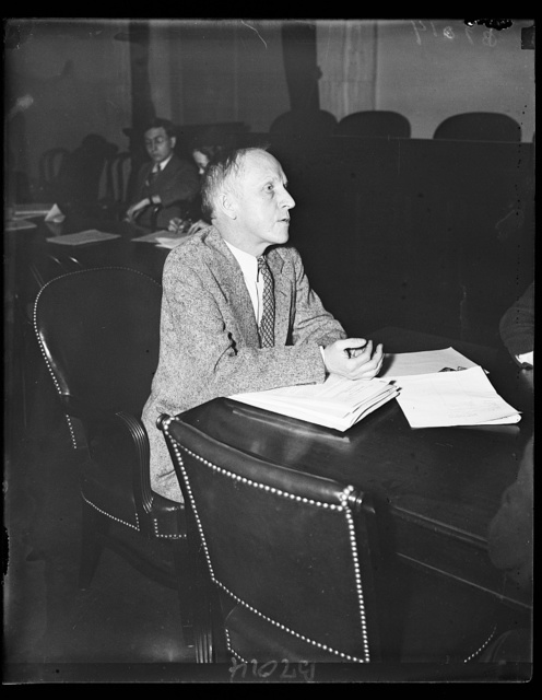 At security hearing. Paul Kellogg, New York City, appears before the Senate Finance Committee considering the Economic Security Act. Kellogg is Editor of Survey Graphic and Vice Chairman of the Advisory Council to the Committee on Economic Security. 2/14/35