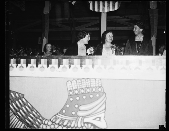 AT SHRINE PARADE. MRS. FRANKLIN ROOSEVELT AND WIVES OF IMPORTANT SHRINERS REVIEW THE NIGHT PARADE OF THE SHRINERS IN CONVENTION HERE. FROM THE LEFT: MRS. LEONARD P. STEUART, WIFE OF THE IMPERIAL POTENTATE-ELECT; MRS. DANA S. WILLIAMS, WIFE OF THE RETIRING IMPERIAL POTENTATE; AND MRS. ROOSEVELT