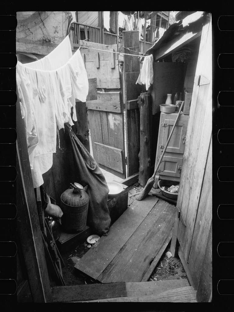Backyard of house near the House office building, showing privy on extreme right with water supply between privy and ice box. This is an alley dwelling and these tiny, overcrowded, dirty backyards are characteristic of this section