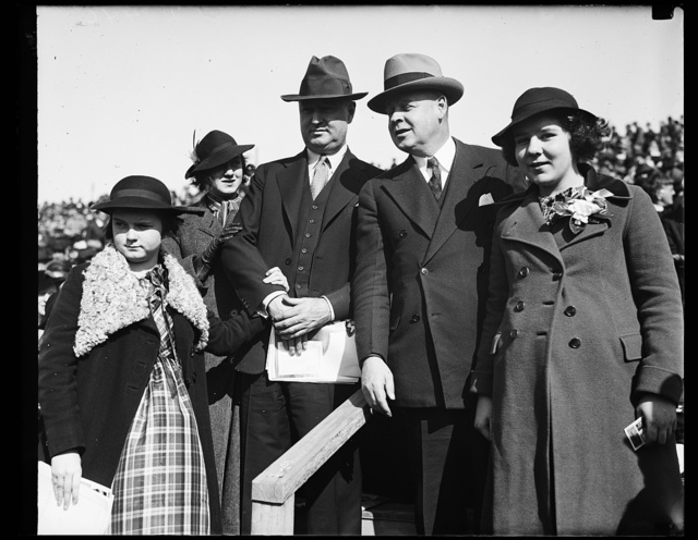 Big game at big game. Left to right, Miss Anne Farley, Miss Betty Farley, Postmaster General James Farley, Frank C. Walker head of the National Emergency Council and his daughter Miss Laura Walker at Navy-Notre Dame game