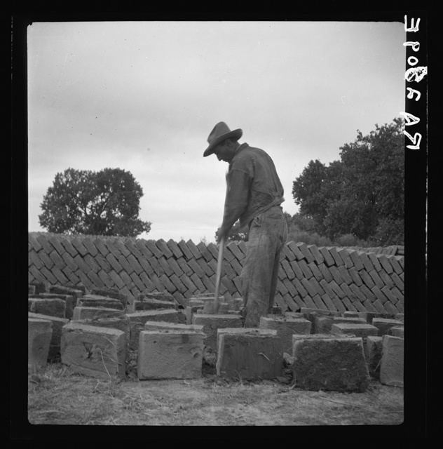 Bosque Farms project. Making adobe brick for school and permanent houses. New Mexico