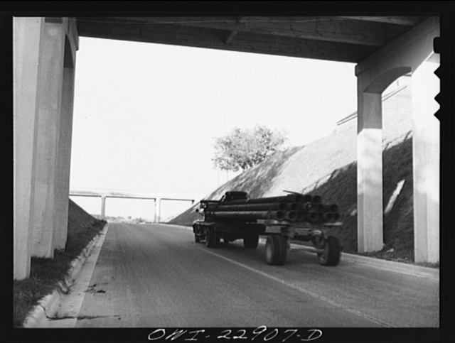 [Burton, Texas.  Load of pipe under Main Street Overpass on Highway 290]